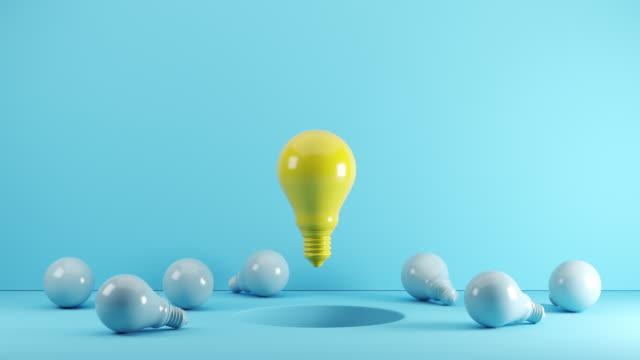 Yellow Light bulb Floating From hole among blue light bulb on floor. 3D Animation