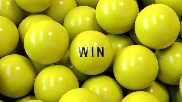 gula lotteri bollar skärmen på med win word i fronten. - lotteri bildbanksvideor och videomaterial från bakom kulisserna