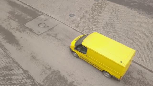 yellow minibus moving along asphalt road. yellow passenger van driving on road - furgone video stock e b–roll