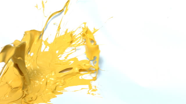 Yellow paint splattering on white background video