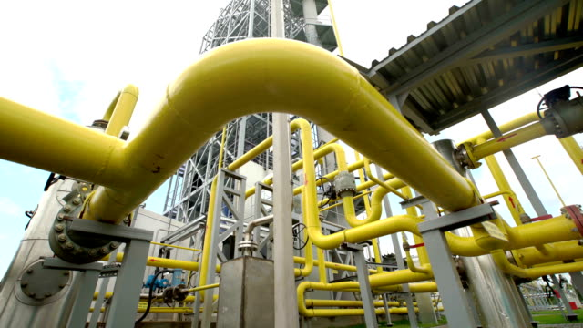 yellow pipe on gas plant. shot with slider video