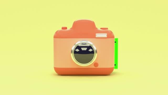 yellow scene pink camera cartoon style blank green screen postcard levitation 3d rendering technology photography concept