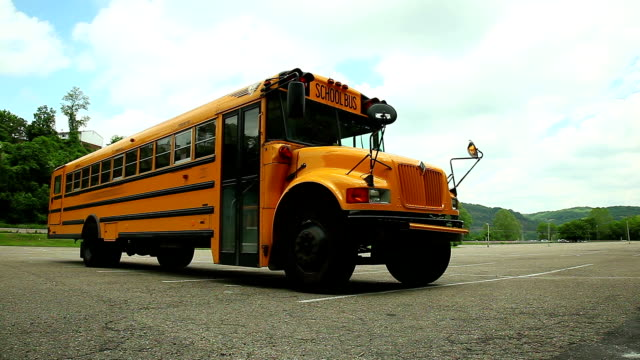 yellow school bus on the parking - school buses stock videos and b-roll footage