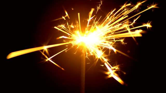 Yellow Sparklers is Sparkling On Black Background 4K Yellow Sparklers is Sparkling On Black Background. Sparkler is sparkling in dark room 4k 3840x2160 high resolution footage for party festival or Holidays theme. {{asset.href}} stock videos & royalty-free footage