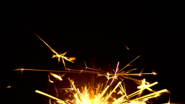 Yellow Sparklers is Sparkling On Black Background Bottom 2 Yellow Sparklers is Sparkling On Black Background. Sparkler is sparkling in dark room 4k 3840x2160 high resolution footage for party festival or Holidays theme {{asset.href}} stock videos & royalty-free footage