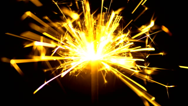 Yellow Sparklers is Sparkling On Black Background Close Up Yellow Sparklers is Sparkling On Black Background. Sparkler is sparkling in dark room 4k 3840x2160 high resolution footage for party festival or Holidays theme {{asset.href}} stock videos & royalty-free footage