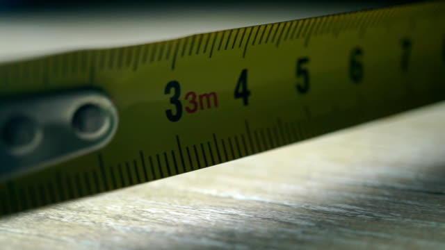 Yellow tape measure macro shot video