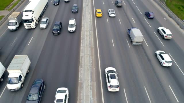 a yellow taxi car moves on a highway under a road bridge. 4k. - автострада стоковые видео и кадры b-roll