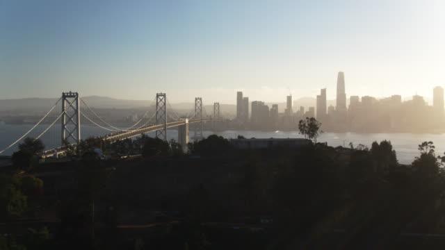 Yerba Buena Island and the Bay Bridge with San Francisco Skyline - Drone Shot video
