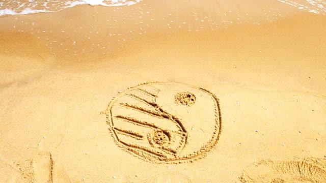 Yin and Yan on sand, the beach. video