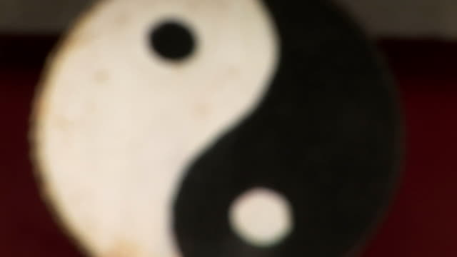 Yin Yang Symbol Comes into focus Weathered yin yang symbol comes into focus, White Cloud Temple, world's oldest Taoist temple, Beijing, China yin yang symbol stock videos & royalty-free footage
