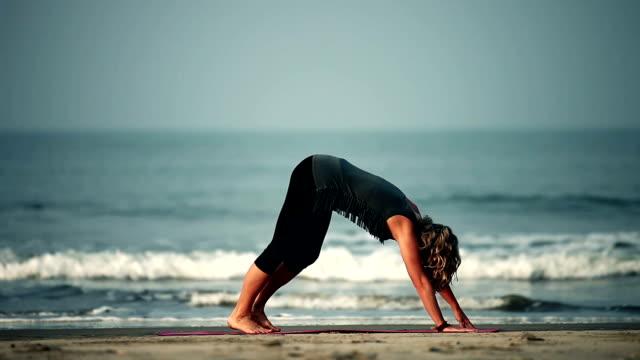 Yoga at the beach (HD 1080) Yoga at the beach of Goa - INDIA yin yang symbol stock videos & royalty-free footage