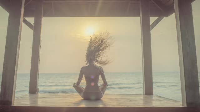 yoga meditation at sunset - spirituality stock videos & royalty-free footage