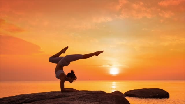 Yoga on the beach sunset Asian woman Yoga on the beach sunset Cinemagraph lotus position stock videos & royalty-free footage