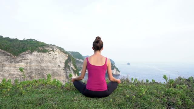 yoga woman. lotus pose. back view - posizione corretta video stock e b–roll