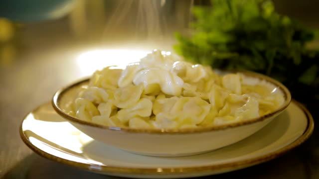 Yogurt being poured on Manti HD 1920x1080 / 25p / Photo-JPEG ravioli stock videos & royalty-free footage