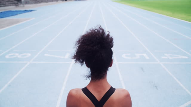 You are more capable than you know Rearview video footage of a female athlete standing on the track athleticism stock videos & royalty-free footage