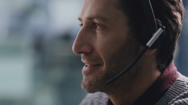 You can always trust on him to sort it out 4k video footage of a handsome male call center agent wearing headsets and working in his office salesman stock videos & royalty-free footage