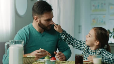 You have something on your nose! Little girl and her father having fun while having breakfast at home breakfast stock videos & royalty-free footage