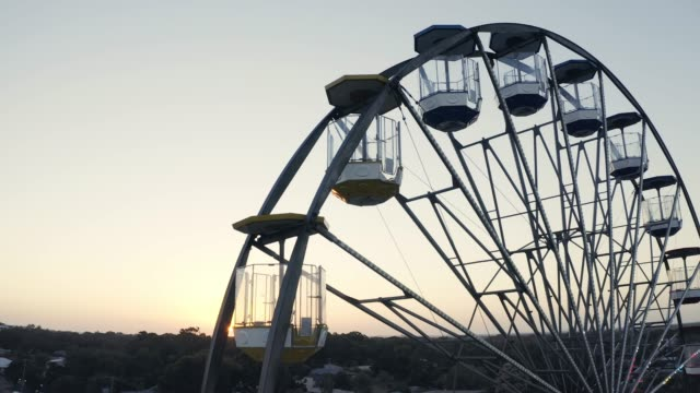 You'll be able to see the world from a different angle 4k video footage of a ferris wheel midday stock videos & royalty-free footage