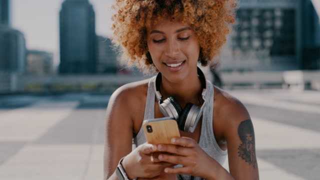 You'll find tons of helpful fitness tutorials online 4k video footage of a sporty young woman using a cellphone while exercising in the city sportsperson stock videos & royalty-free footage