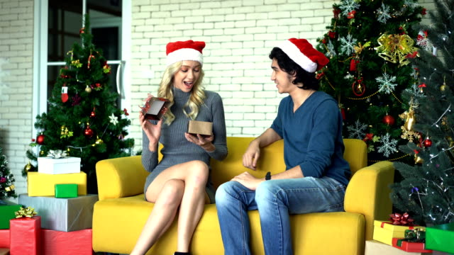 Yound Male Surprise His Girlfriend By Giving A Gift In Christmas Day