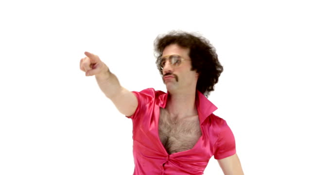 Young 70s curly hair man close-up dressing fuchsia vintage shirt make dance steps on 103 bpm music track - isolated-on-white HD video footage video