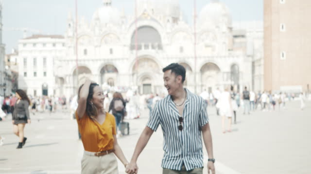 Young adult asian couple exploring Venice, Italy