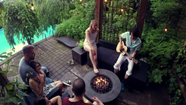 Young Adult  Campfire Guitar Singing Pool Party outdoor Summer BBQ video