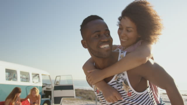 Young adult couple at the beach 4k