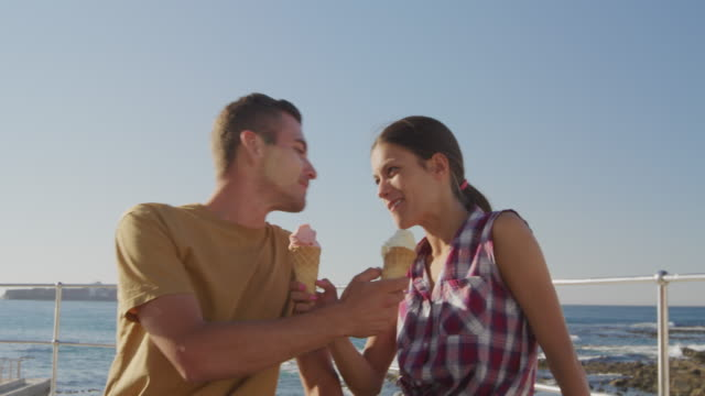 Young adult couple relaxing at the seaside