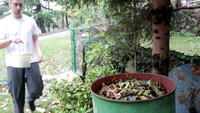 Young Adult Man Composting Organic Waste - Stock Video video