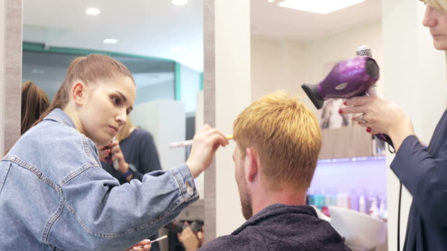 Young Adult ManFashion Model Getting Prepared