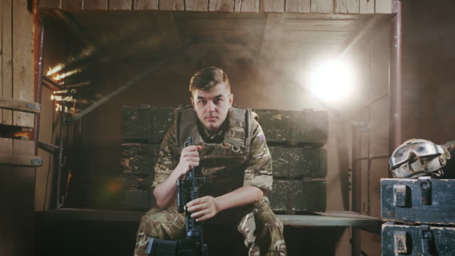 Young adult military man in camouflage. Soldier with a machine gun in the army. Portrait of an English military sad man. Soldier with a machine gun in the army. Young adult 20s. National patriot in london. Patriotic nationalism. Officer for safety. Operation of security in camp. camouflage clothing stock videos & royalty-free footage