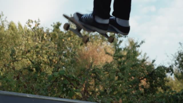 Young adult skateboarding halfpipe 4k super slow motion