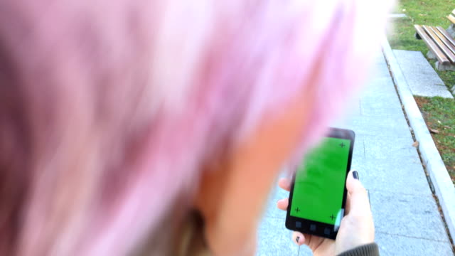 Young Adult Woman Using Smart Phone with Greenscreen on City Street video