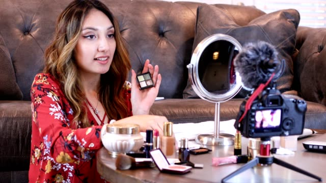 Young adult woman vlogging about cosmetics, skin care products. video
