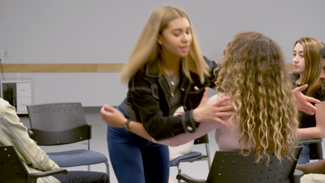 Video Young adults comforting each other at group therapy
