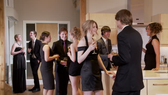young adults in a party scene video