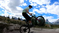 istock Young adults take bike jumps in mountain park 1271333991
