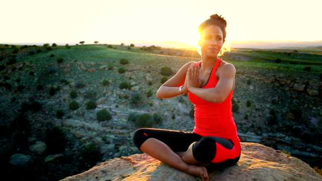 Young African American Woman Doing Yoga in Desert video