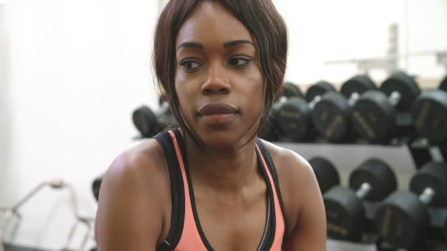 Young African American woman drinking protein shake at a gym Young African American woman drinking protein shake at a gym protein stock videos & royalty-free footage