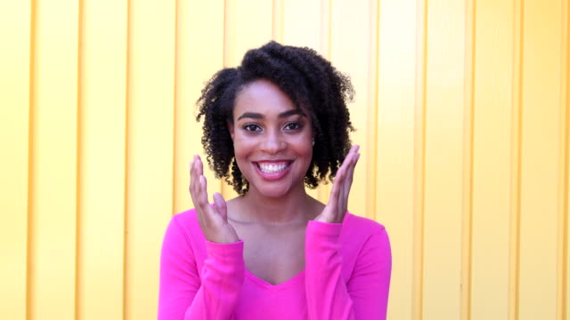 Young African American woman smiling and touching face video