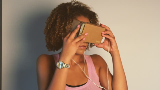 Young African American Woman Using Virtual Reality Device video