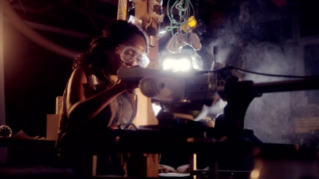Young african ethnicity woman working in Wood Workshop - video