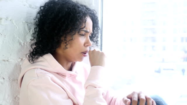 Young African Woman Coughing, Throat infection Young African Woman Coughing, Throat infection coughing stock videos & royalty-free footage