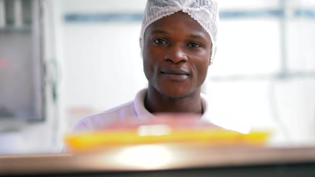 Young african working at the butchery weighing the meat video