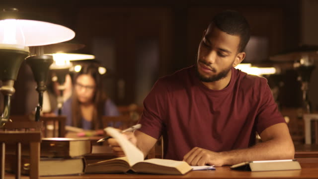 DS Young African-American man studying in the library video