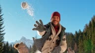 istock SLO MO Young African-American man throwing a snowball into the camera 958978140