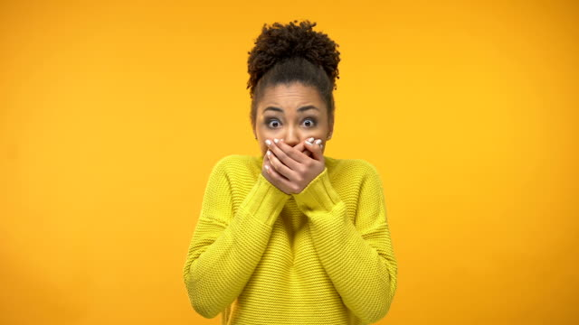 young african-american woman closing mouth with hands, keeping secret, gossip - proibizione video stock e b–roll